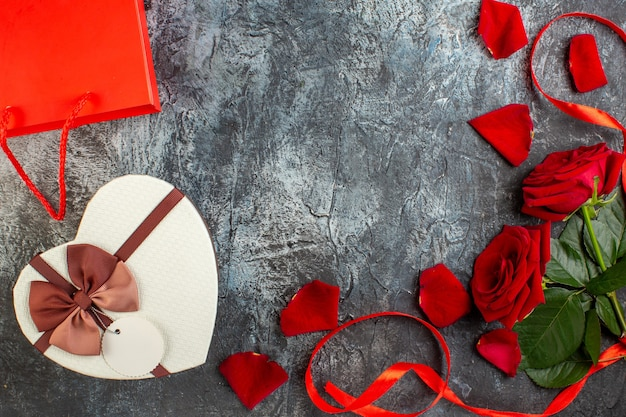 Top view valentines day present with red roses on light gray background couple marriage love holiday heart passion