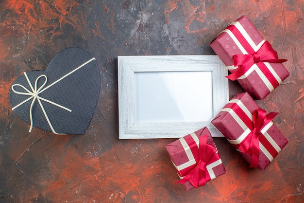 Top view valentines day presents with picture frame on the dark surface i love you feeling photo lover color gift love