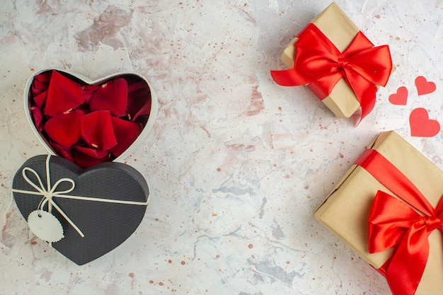Top view valentines day presents with red bow on a light background color lover couple marriage heart feeling love