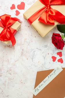 Top view valentines day presents with red bow on a light background color lover marriage heart love rose couple feeling
