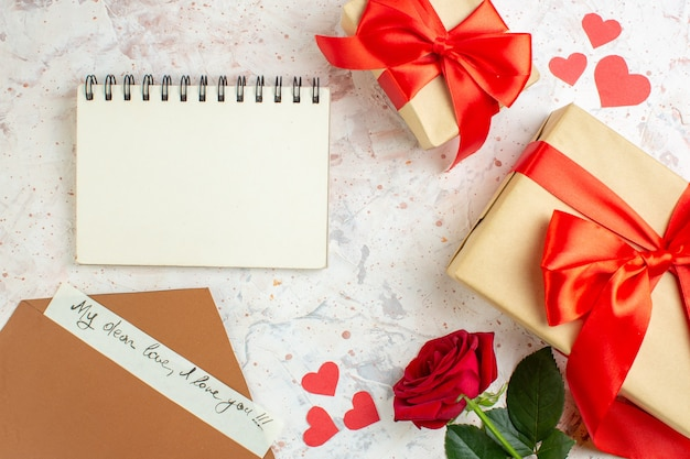 Top view valentines day presents with red bow on light background color lover marriage love rose couple feeling