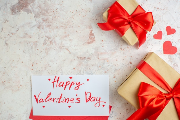 Top view valentines day presents with red bow on a light background lover love couple marriage heart color feeling