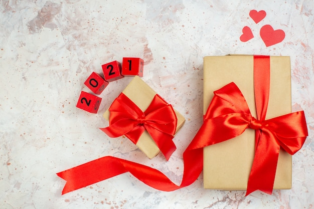 Top view valentines day presents with red bow on light background lover love couple marriage heart color feeling