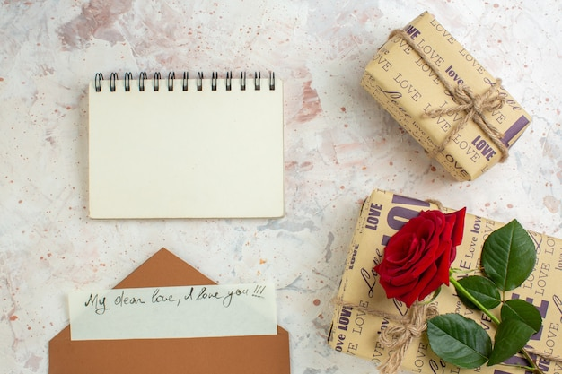 Top view valentines day presents with red rose on light background marriage feeling passion love lover heart color note