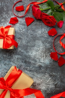 Top view valentines day presents with red roses for valentines day on light gray background couple marriage passion love holiday feeling heart