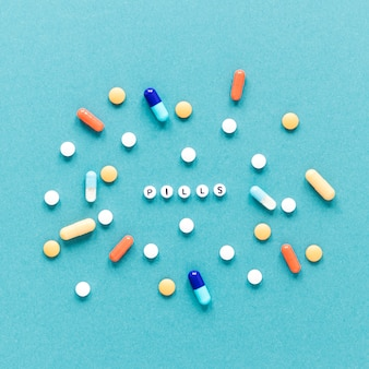 Top view variety of colorful pills on the table