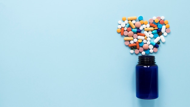 Top view variety of colorful pills with copy space