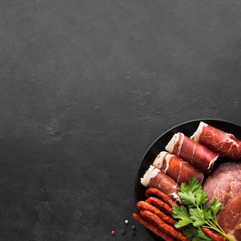 Top view variety of meat on the table with copy space