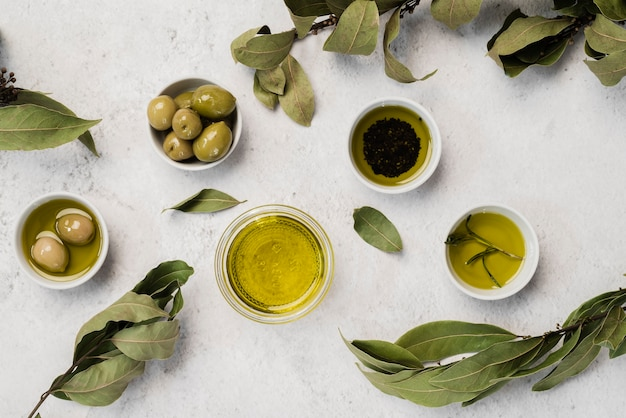 Top view variety of olive oil and olives