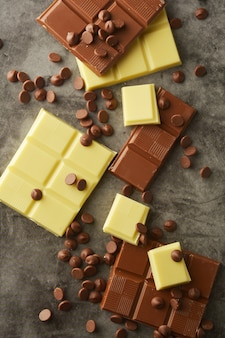 Top view of various chocolate bars with copy space.