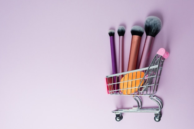 Top view on various makeup accessories