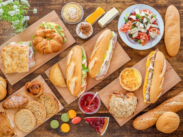 Top view of various tasty dishes on wooden surface