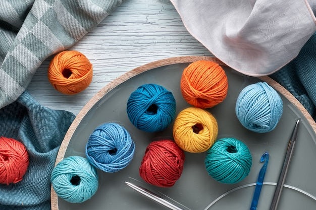 Top view of various yarn balls and latch hook