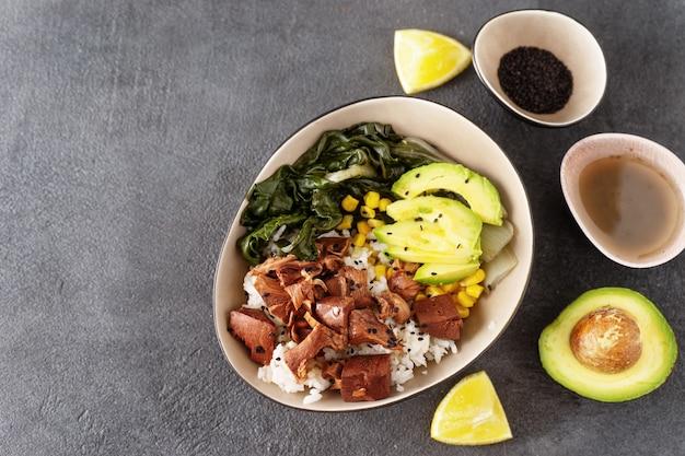 Top view of vegan healthy bowl with rice, salad and jackfruit