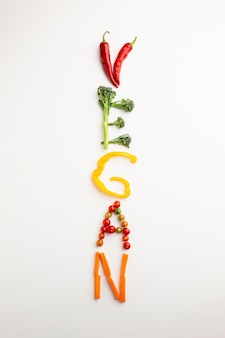 Top view vegan lettering made out of vegetables