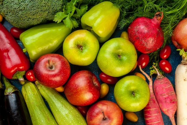 Top view vegetable composition with fresh fruits on blue table