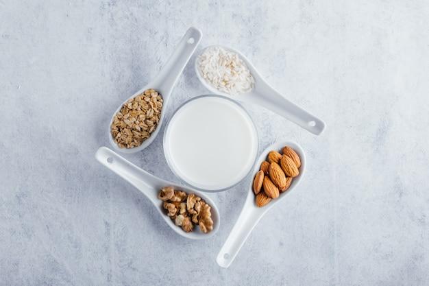 Top view of vegetable milk, almond milk, walnut milk, rice milk, and oat milk
