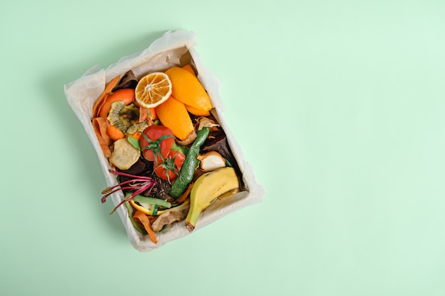 Top view vegetable peels in compost bin, compost concept. sustainable and zero waste, food leftovers