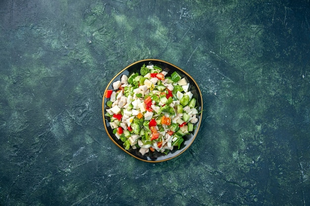 Top view vegetable salad consists of cheese cucumbers and tomatoes on dark blue background color health lunch fresh food meal