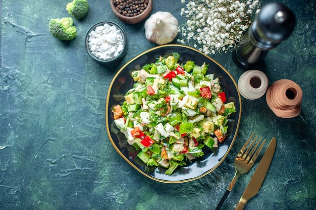 Top view vegetable salad consists of cucumber cheese and tomatoes on dark-blue background meal health diet food lunch cuisine colors restaurant