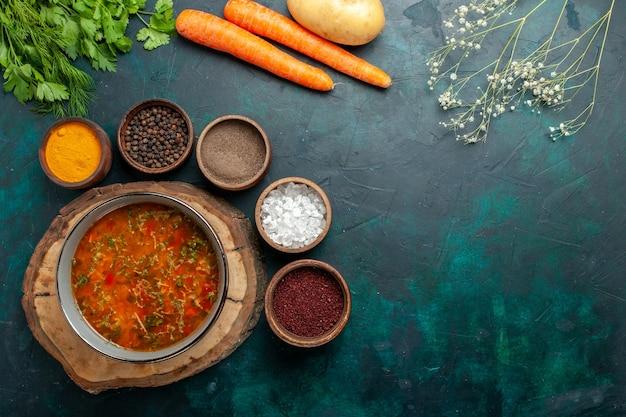 Top view vegetable soup with seasonings on dark-green background ingredient soup meal food vegetable