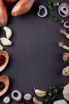 Top view of vegetables as shallot garlic scallion egg onion on maroon background with copy space