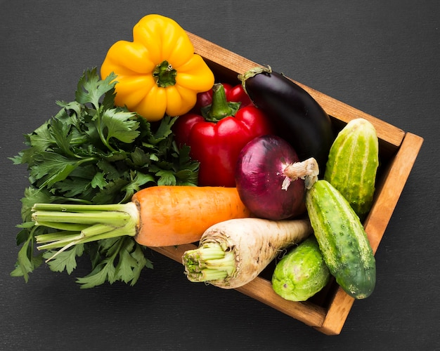 Top view vegetables assortment on dark background