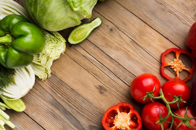 Top view vegetables assortment on wooden background with copy space