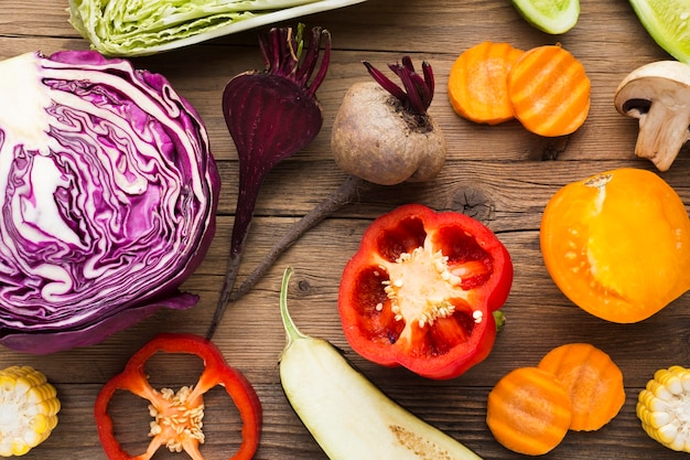 Top view vegetables composition on wooden background