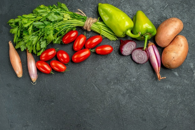 Top view of vegetables with free place for your text on dark grey-green background