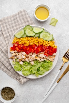 Top view veggie salad with chicken and herbs