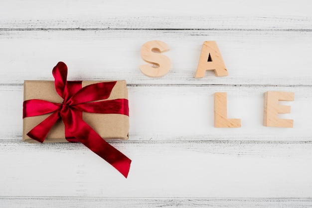Top view view of present on wooden background