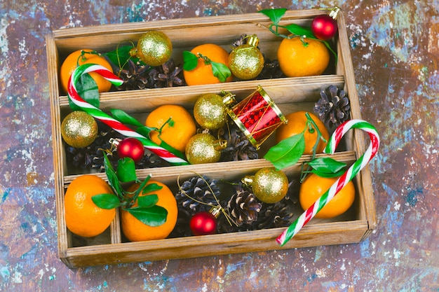 Top view vintage christmas box with decorations