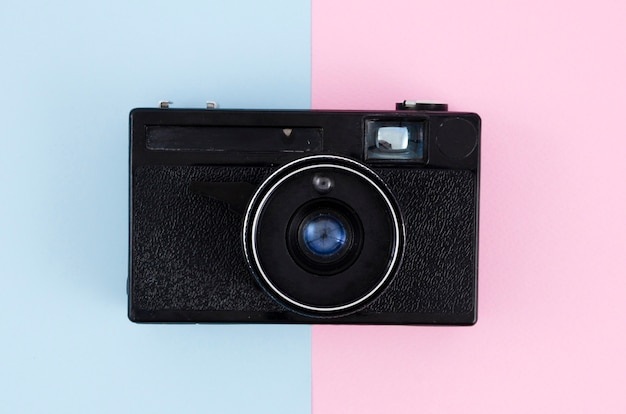 Top view vintage photo camera with colourful background