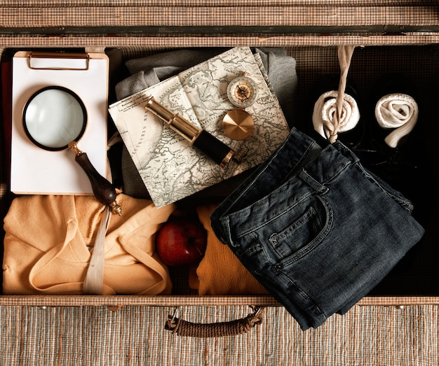 Top view vintage suitcase with casual clothes