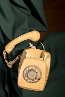 Top view vintage yellow telephone