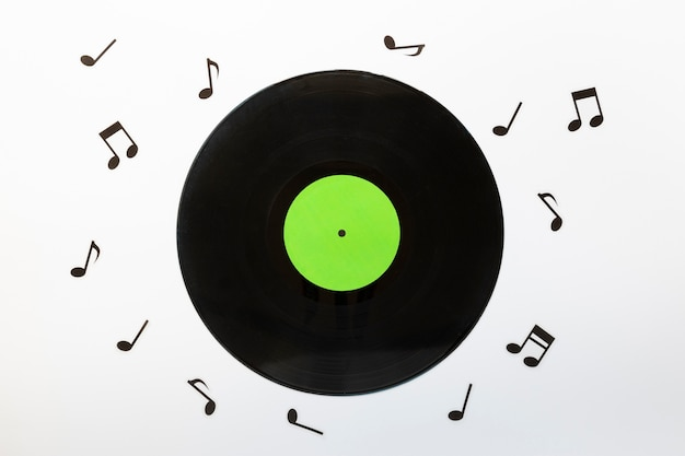 Top view vinyl disc with musical notes