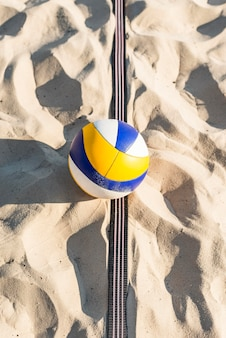 Top view of volleyball on the beach sand