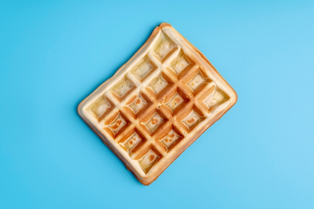 Top view of waffle on blue background