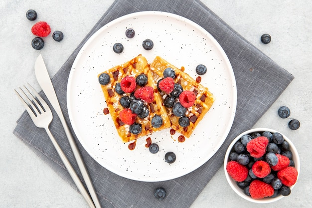 Top view waffle on plate with forest fruit