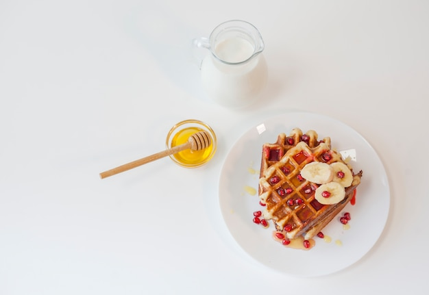 Top view waffle with honey and milk