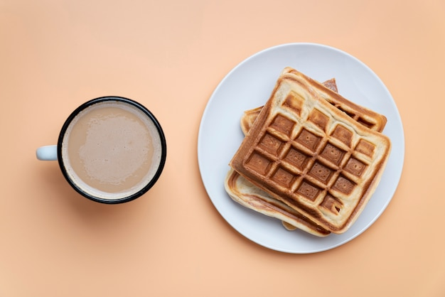Top view of waffles on plate with beverage