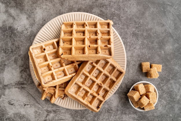 Top view of waffles on plate with sugar cubes