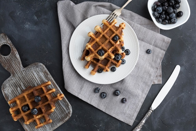 Top view waffles with blueberries