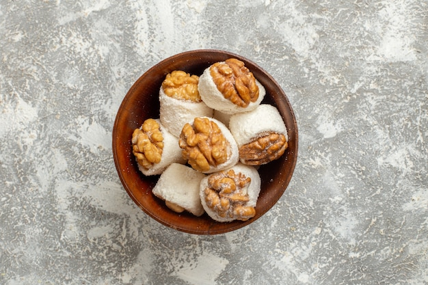 Top view walnut confitures sweet candies on white background