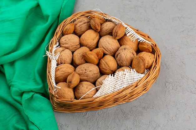 Top view walnuts inside basket on the grey background