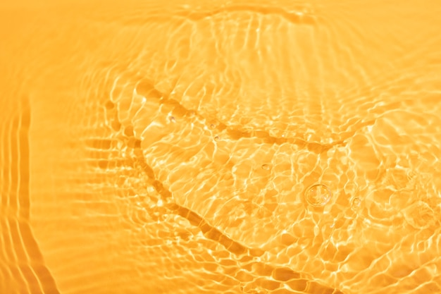 Top view water texture on orange
