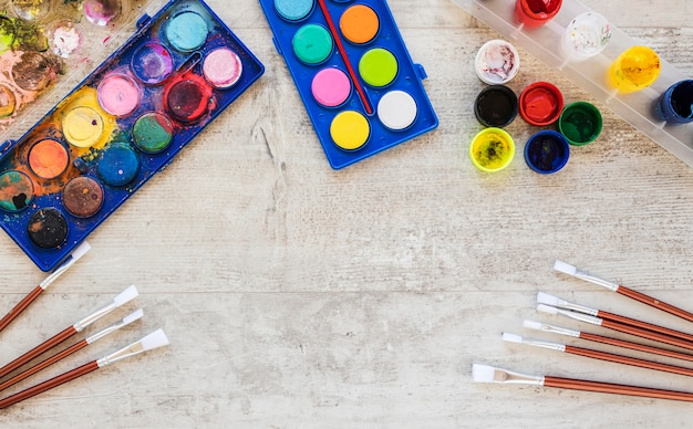 Top view watercolor paint and paint brushes