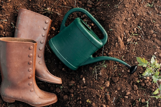 Top view of watering can and boots