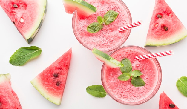 Top view of watermelon cocktail glasses with straws and mint